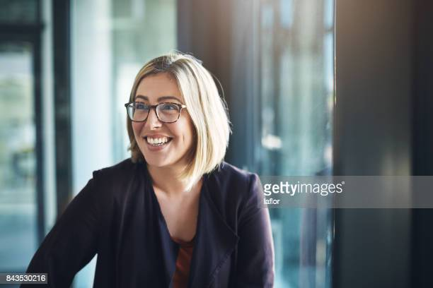 bringing positive energy to the workplace - happy stock photos and pictures