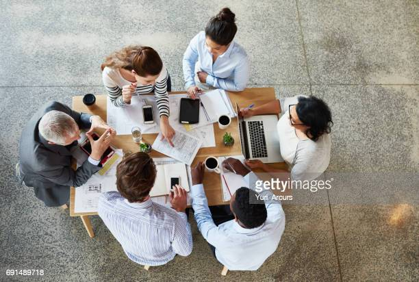 bringing their ideas together - business strategy stock photos and pictures