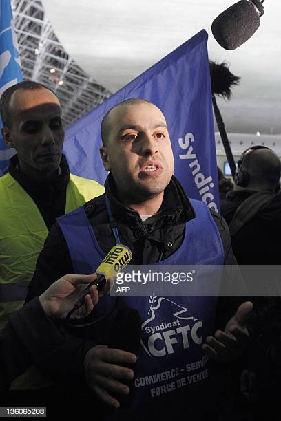 Brink's airport access control company CFTC union representative Farid Ouariach speaks to the press on December 22 2011 at the Paris international...