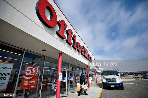 Brink's Inc. Security officer exits an OfficeMax Inc. Store in Peoria, Illinois, U.S., on Tuesday, Feb. 19, 2013. Office Depot Inc. And OfficeMax...