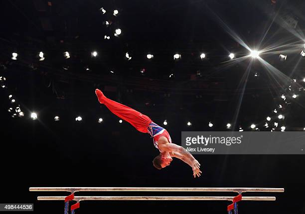 Brinn Bevan of Great Britain competes in the Parallel Bars during day three of the 2015 World Artistic Gymnastics Championships at The SSE Hydro on...