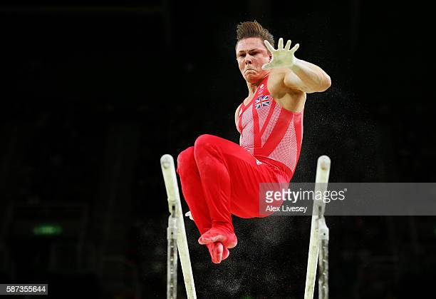 Brinn Bevan of Great Britain competes on the parallel bars during the men's team final on Day 3 of the Rio 2016 Olympic Games at the Rio Olympic...