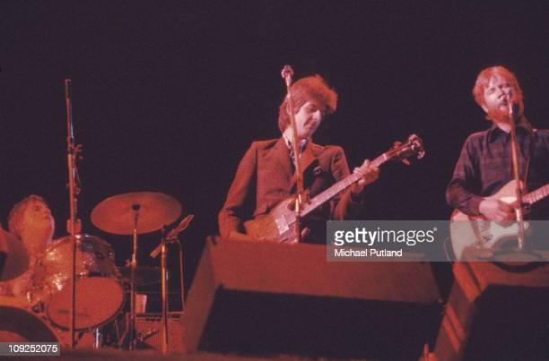 Brinsley Schwarz perform on stage in London L-R Billy Rankin, Nick Lowe, Ian Gomm.
