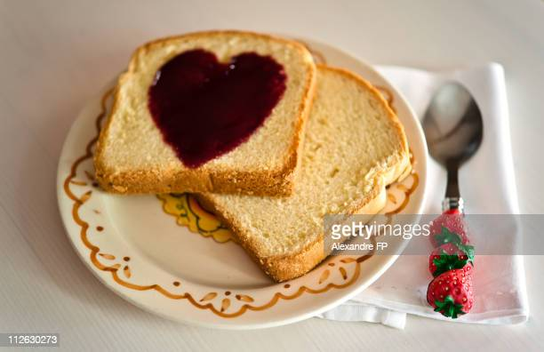 Brioche and a Heart of  berry coulis