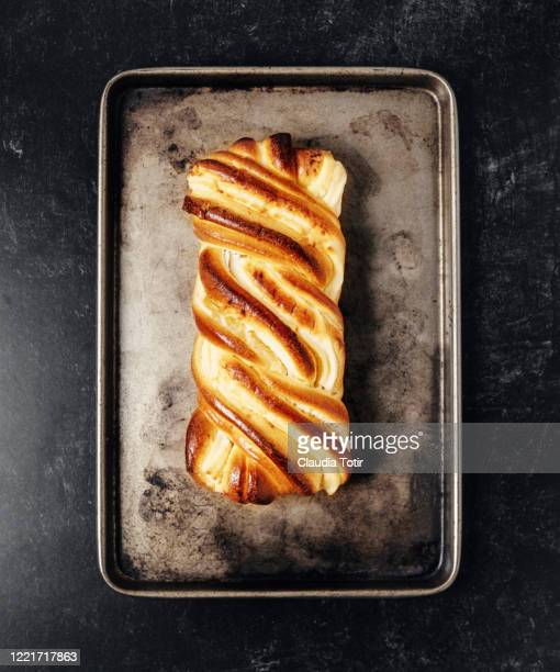brioche cream cheese swirl on tray on black background - brioche stock pictures, royalty-free photos & images