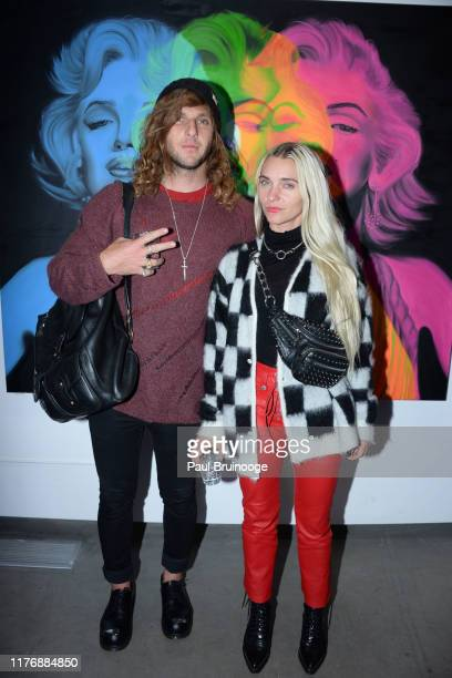Brion Isaacs and Heather Andersen attend Delusions of the Wild Solo Exhibition By Alexandra Houx Grounds at 213 Bowery on October 17 2019 in New York...