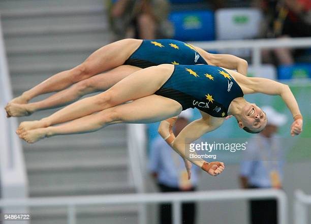 Briony Cole right and Melissa Wu of Australia perform a flip in the women's 10meter synchronized diving event during day four of the 2008 Beijing...