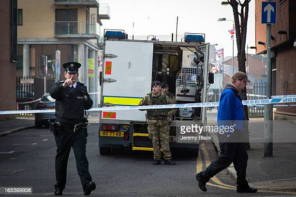 Brirish Army bomb disposal unit attend a bomb alert on Great Victoria Street Belfast Northern Ireland on 5 March 2013 Meanwhile a PSNI police officer...