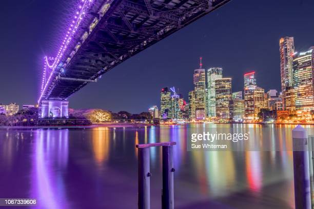 brisbane at night - brisbane stock photos and pictures