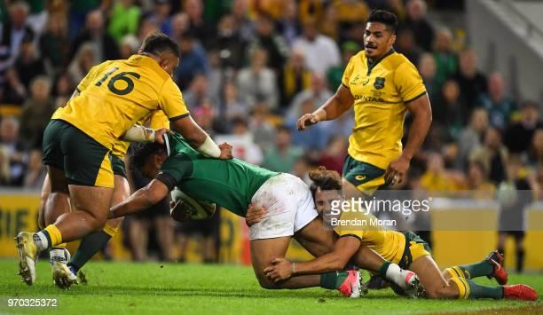 Brisbane Australia 9 June 2018 Bundee Aki of Ireland is tackled by Tolu Latu left and Nick Phipps of Australia during the 2018 Mitsubishi Estate...