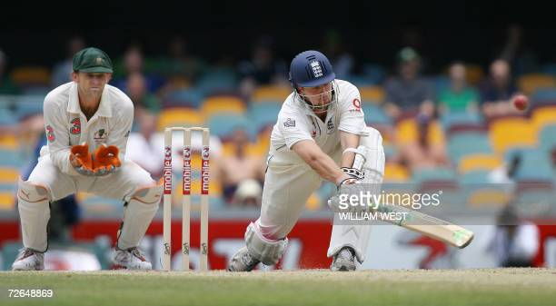 England batsman Steve Harmison hits out against the bowling as Australian wicketkeeper Adam Gilchrist looks on on the final day of the first Ashes...