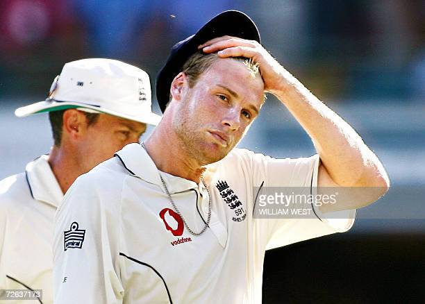 England captain Andrew Flintoff wipes his brow as he and teammate Ashley Giles leave the field after Australia posted a massive score on the second...