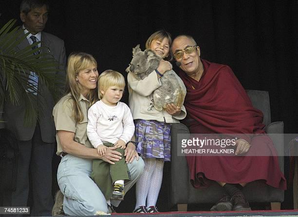 Tibet's spiritual leader the Dalai Lama hugs Bindi Irwin holding a koala, flanked by her mother Terri , widow of late Crocodile Hunter Steve Irwin,...