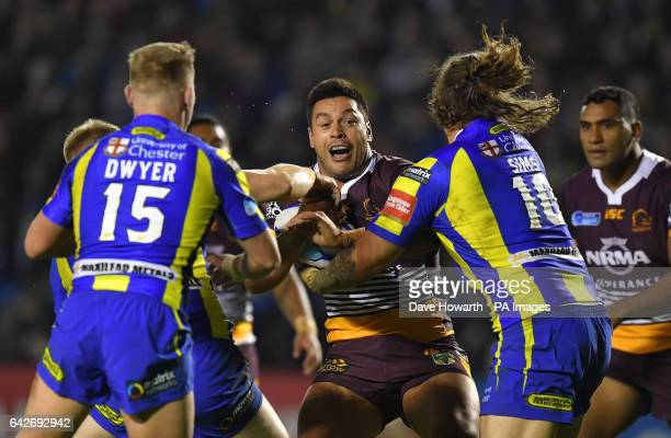 Brisbane Broncos' Alex Glenn is stopped by Warrington Wolves' Ashton Sims and Brad Dwyer during the 2017 Dacia World Club Series match at the...