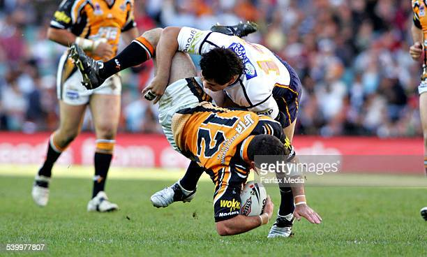 Brisbane Broncos Corey Parker upends the West Tigers Mark O'Neill in a tackle during the NRL rugby league semifinal at Aussie Stadium 18 September...