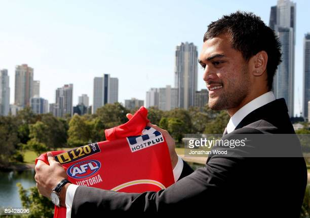 Brisbane Broncos NRL player Karmichael Hunt talks to the media during a press conference to announce that will be switching codes to play AFL for the...