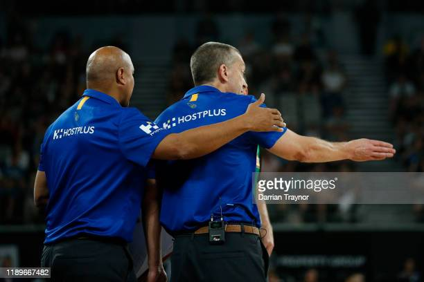 Brisbane Bullets assistant coach CJ Bruton guides Brisbane Bullets coach Andrej Lemanis away from the referee during the round 8 NBL match between...