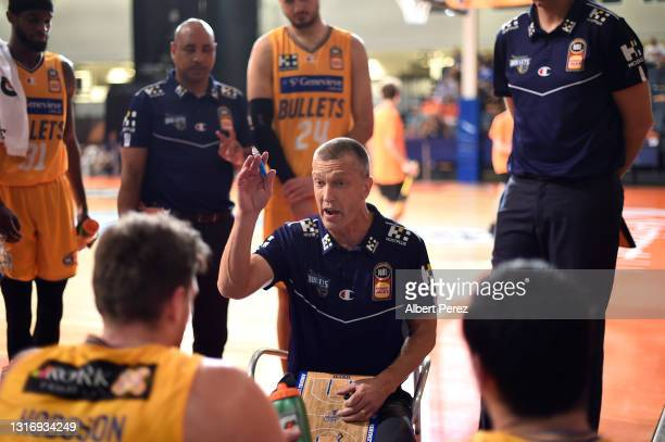 Brisbane Bullets coach Andrej Lemanis speaks to his players during the round 17 NBL match between the Cairns Taipans and the Brisbane Bullets at...