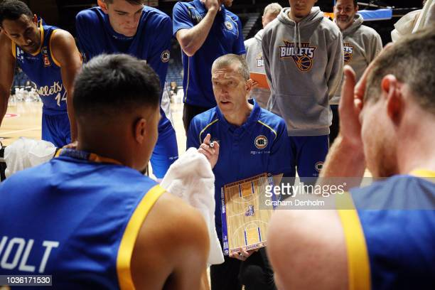 Brisbane Bullets Head Coach Andrej Lemanis talks to his players during the NBL Blitz preseason match between Brisbane Bullets and Illawara Hawks at...