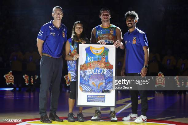 Brisbane coach Andrej Lemanis, jersey artist Akala Sandy, Jason Cadee and Verle Williams pose with the Bullets Indigenous jersey during the round 18...
