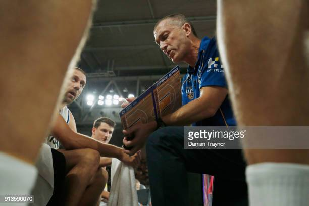 Brisbane coach Andrej Lemanis speaks with his players in a time out during the round 17 NBL match between Melbourne United and the Brisbane Bullets...