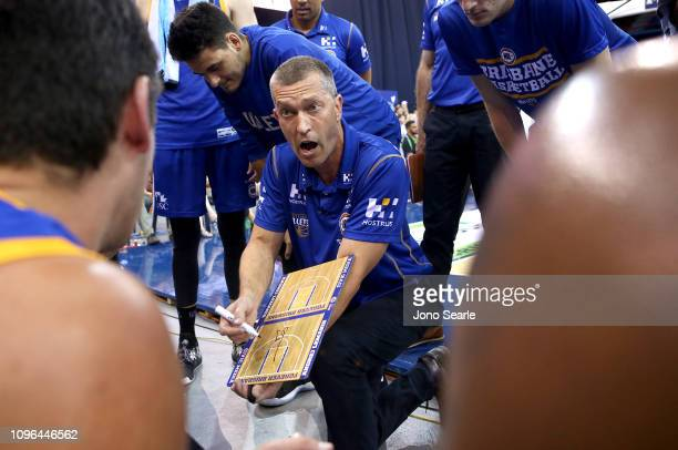 Brisbane coach Andrej Lemanis talks to his team in a timeout during the round 14 NBL match between the Brisbane Bullets and the Cairns Taipans at the...