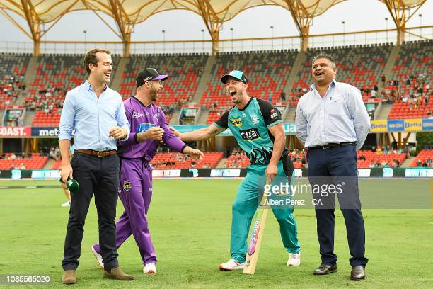 Brisbane Heat captain Chris Lynn and Hobart Hurricanes captain Matthew Wade laugh before the bat flip during the Big Bash League match between the...