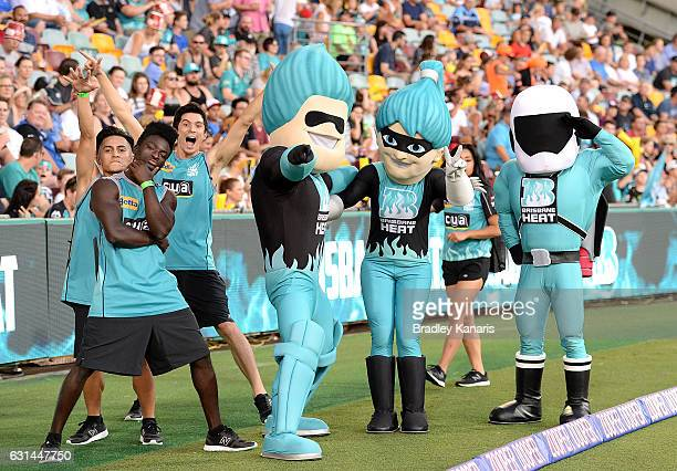Brisbane Heat mascots and entertainers pose for a photo during the Big Bash League match between the Brisbane Heat and the Perth Scorchers at The...