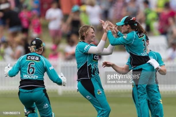 Brisbane Heat players celebrate the dismissal of Rachael Haynes during the Women's Big Bash League Semi Finals on January 19 2019 in Sydney Australia