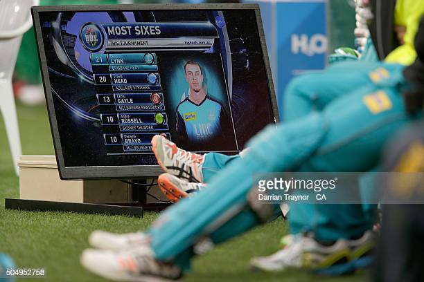 Brisbane Heat players waiting to bat watch the TV broadcast from the bench during the Big Bash League match between the Melbourne Stars and the...