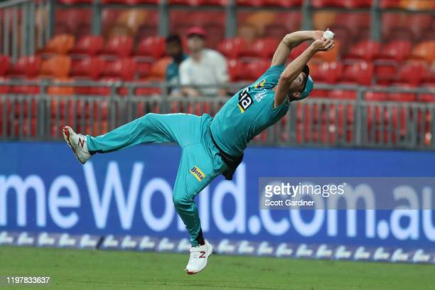 Brisbane Heat's Ben Laughlin catches Sydney Thunder's Daniel Sams during the Big Bash League match between the Sydney Thunder and the Brisbane Heat...