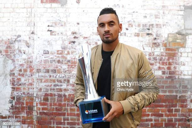 Brisbane International winner Nick Kyrgios poses with the trophy at the Brisbane Powerhouse on January 8 2018 in Brisbane Australia
