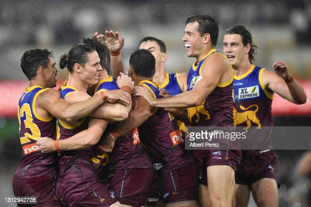 Brisbane Lions celebrate a Jaxon Prior goal during the round five AFL match between the Brisbane Lions and the Essendon Bombers at The Gabba on April...