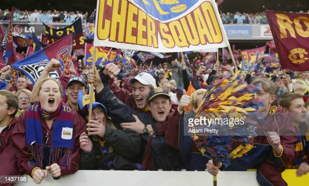 Brisbane Lions fans celebrate victory after the 2002 AFL Grand Final between the Collingwood Magpies and the Brisbane Lions played at the Melbourne...