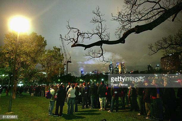 Brisbane Lions fans queue for Grand Final tickets outside the MCG after the AFL Second Preliminary Final match between The Brisbane Lions and the...