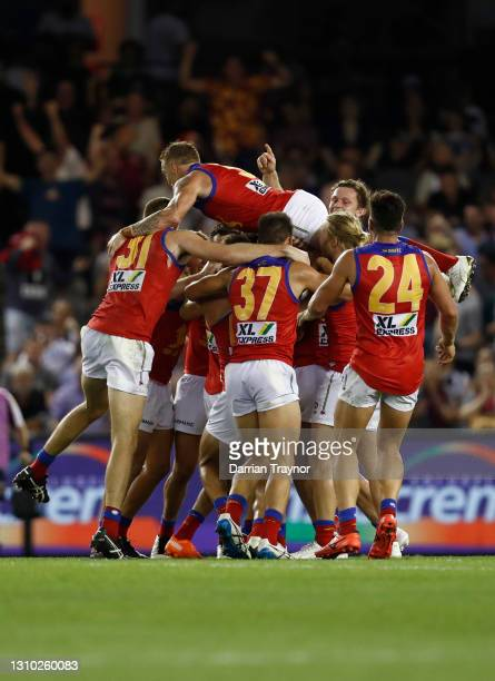 Brisbane Lions players celebrate an after the siren goal to win the game by Zac Bailey during the round 3 AFL match between the Collingwood Magpies...