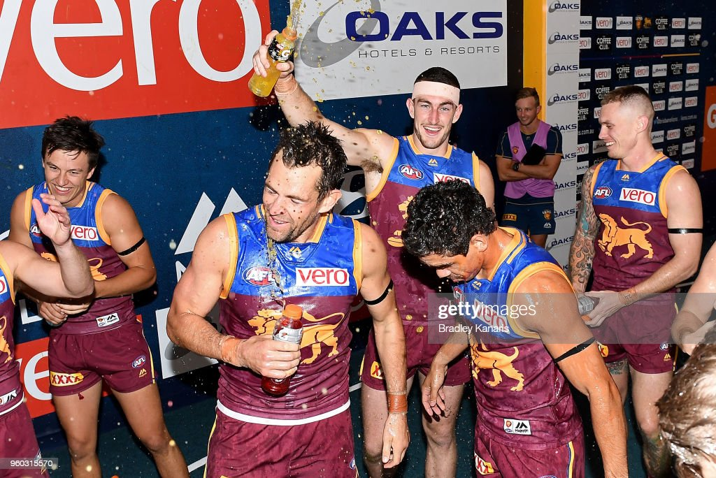 Brisbane Lions players celebrate victory after the round nine AFL match between the Brisbane Lions and the Hawthorn Hawks at The Gabba on May 20, 2018 in Brisbane, Australia.
