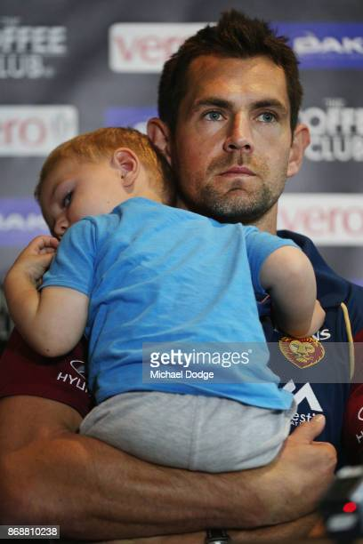 Brisbane Lions recruit Luke Hodge holds son Leo when speaking to media during a Brisbane Lions AFL media opportunity at WRAP on Southbank on November...