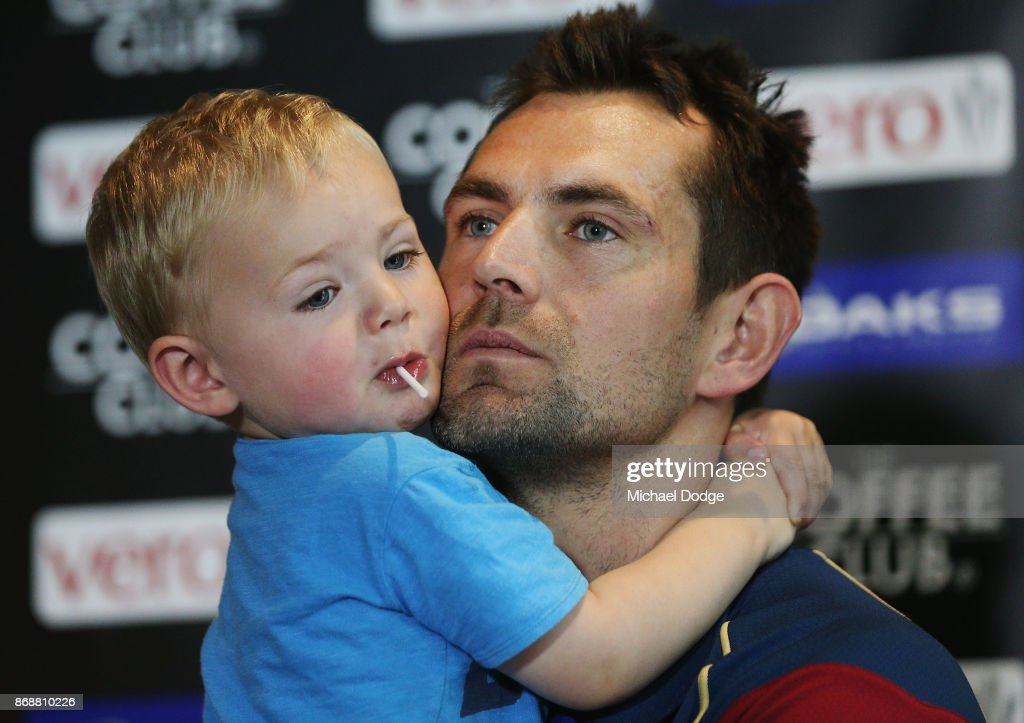 Brisbane Lions recruit Luke Hodge is hugged by son Leo when speaking to media during a Brisbane Lions AFL media opportunity at WRAP on Southbank on November 1, 2017 in Melbourne, Australia.