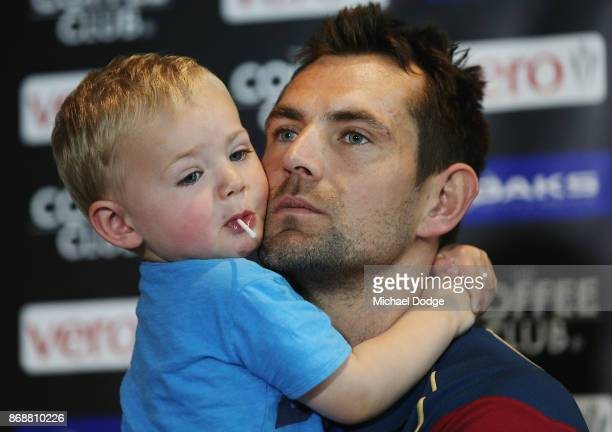 Brisbane Lions recruit Luke Hodge is hugged by son Leo when speaking to media during a Brisbane Lions AFL media opportunity at WRAP on Southbank on...