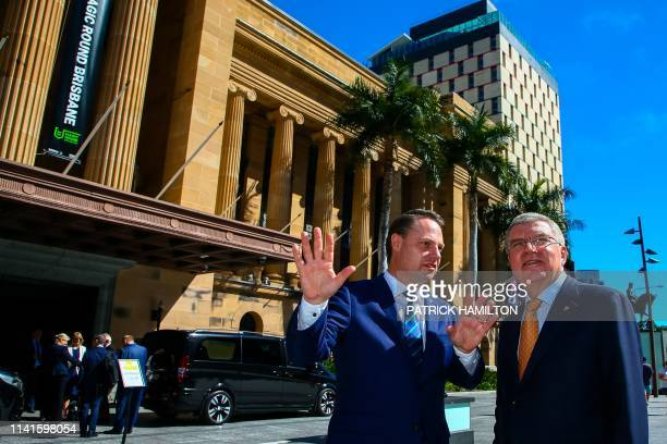 Brisbane Lord Mayor Adrian Schrinner briefs International Olympic Committee president Thomas Bach outside the City Hall after a press conference in...