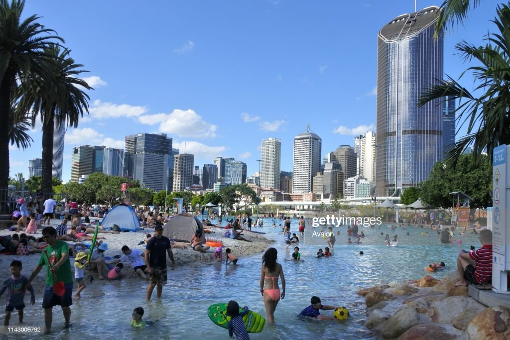 Brisbane People swimming in streets beach public swimming pool and parklands in Brisbane city, Queensland, Australia : News Photo