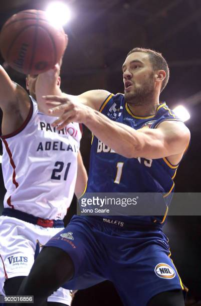 Brisbane player Adam Gibson passes the ball during the round 13 NBL match between the Brisbane Bullets and the Adelaide 36ers at Brisbane Convention...