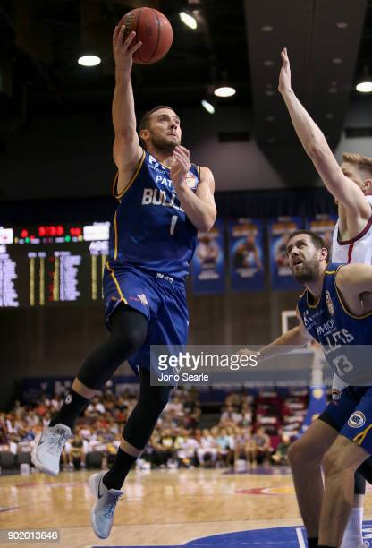 Brisbane player Adam Gibson shoots the ball during the round 13 NBL match between the Brisbane Bullets and the Adelaide 36ers at Brisbane Convention...
