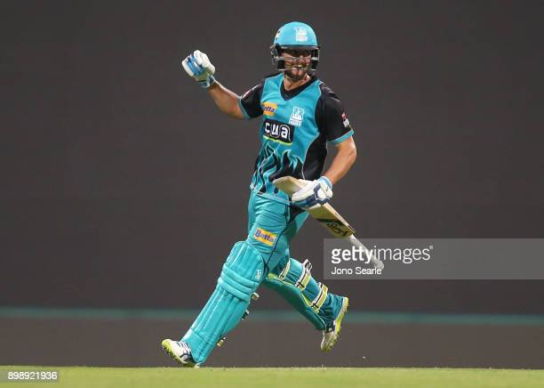 Brisbane player Alex Ross celebrates hitting the winning runs during the Big Bash League match between the Brisbane Heat and the Sydney Thunder at...
