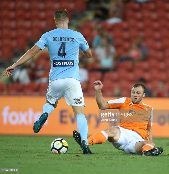 Brisbane player Avram Papadopoulos challenges Melbourne player Harrison Delbridge during the round 19 ALeague match between the Brisbane Roar and...