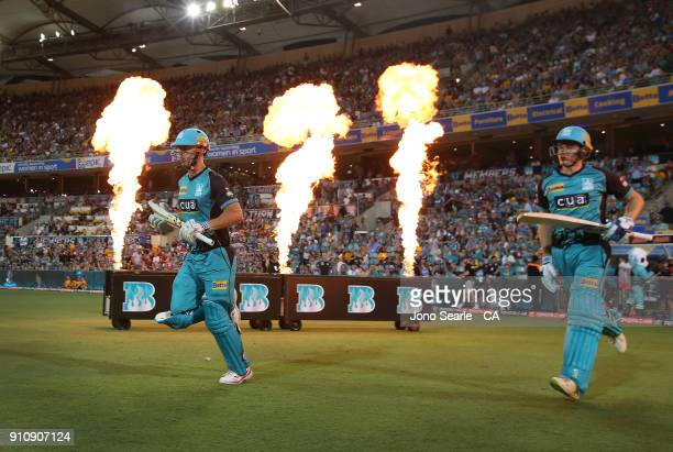 Brisbane player Chris Lynn and Sam Heazlett run out to bat during the Big Bash League match between the Brisbane Heat and the Melbourne Renegades at...