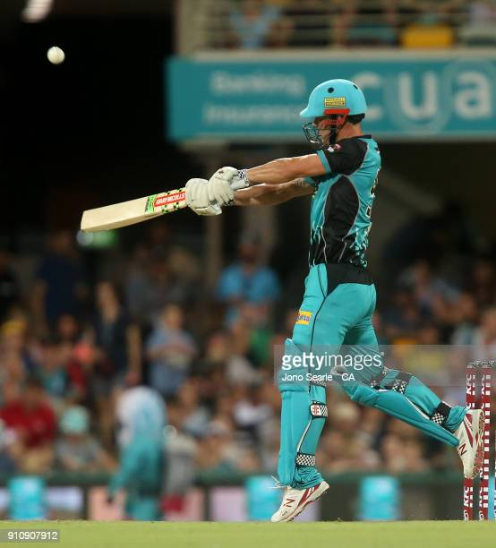 Brisbane player Chris Lynn hits a boundary during the Big Bash League match between the Brisbane Heat and the Melbourne Renegades at The Gabba on...