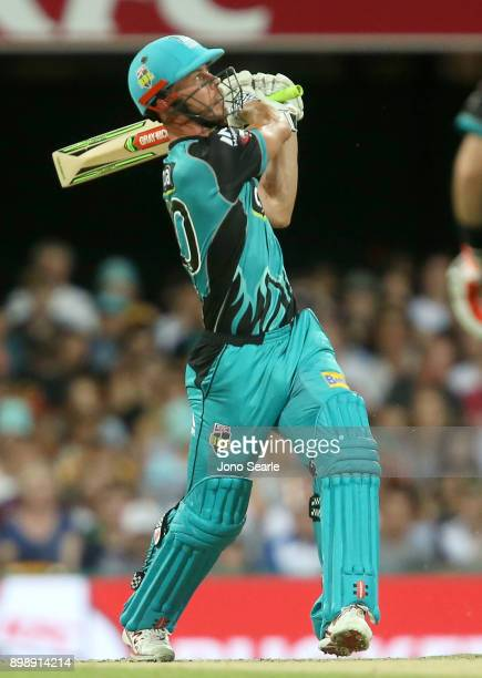 Brisbane player Chris Lynn hits the ball during the Big Bash League match between the Brisbane Heat and the Sydney Thunder at The Gabba on December...