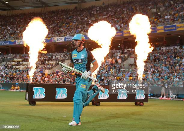 Brisbane player Chris Lynn runs out to bat during the Big Bash League match between the Brisbane Heat and the Melbourne Renegades at The Gabba on...